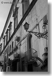 black and white, buildings, europe, gallipoli, italy, lamp posts, puglia, vertical, photograph
