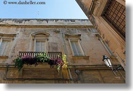 balconies, europe, flowers, horizontal, italy, lamp posts, lecce, puglia, upview, windows, photograph