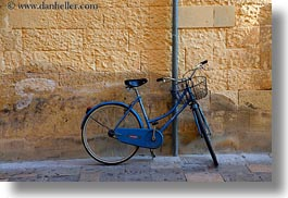 bicycles, europe, horizontal, italy, lecce, puglia, walls, yellow, photograph