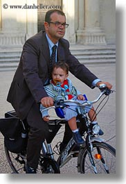 babies, bicycles, emotions, europe, humor, italy, lecce, men, people, puglia, vertical, photograph