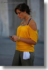 cells, europe, italy, lecce, people, phones, puglia, vertical, womens, yellow, photograph