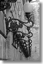black and white, europe, italy, lamp posts, lecce, lights, puglia, rows, street lamps, vertical, photograph