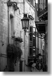balconies, black and white, europe, italy, lamp posts, lecce, lights, puglia, street lamps, vertical, photograph