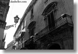 balconies, black and white, europe, horizontal, italy, lamp posts, lecce, lights, perspective, puglia, street lamps, upview, photograph