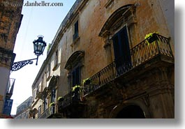 balconies, europe, horizontal, italy, lamp posts, lecce, lights, perspective, puglia, street lamps, upview, photograph