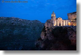 churches, cliffs, dusk, europe, glow, horizontal, italy, lights, matera, puglia, photograph