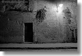 black and white, europe, horizontal, italy, matera, plants, puglia, slow exposure, walls, photograph