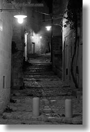 black and white, cobblestones, europe, glow, italy, lights, matera, narrow, nite, puglia, slow exposure, streets, towns, vertical, photograph