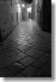 black and white, cobblestones, europe, glow, italy, lights, long exposure, matera, narrow, nite, puglia, streets, towns, vertical, photograph