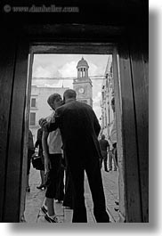 black and white, churches, doors, europe, italy, noci, people, puglia, vertical, photograph