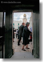 churches, doors, europe, italy, noci, people, puglia, vertical, photograph