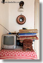 artifacts, books, europe, italy, masseria murgia albanese, noci, puglia, small, televisions, vertical, photograph