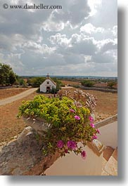 churches, clouds, europe, italy, masseria murgia albanese, noci, plants, puglia, vertical, photograph