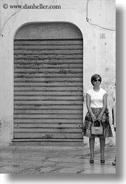 black and white, doors, europe, italy, noci, people, puglia, standing, vertical, womens, photograph