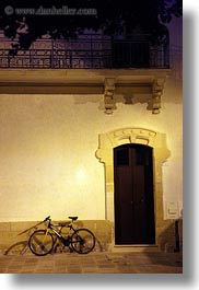 bicycles, bikes, doors, europe, italy, nite, otranto, puglia, vertical, photograph