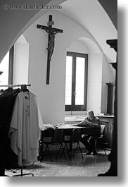 black and white, churches, europe, italy, otranto, paper, priests, puglia, reading, vertical, photograph