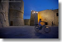 bicycles, castles, childrens, europe, evening, horizontal, italy, otranto, people, puglia, photograph