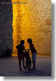 bicycles, castles, childrens, europe, evening, italy, otranto, people, puglia, vertical, photograph