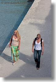 blonds, europe, italy, otranto, people, puglia, two, vertical, walking, womens, photograph