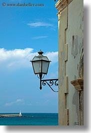 clouds, europe, italy, lamp posts, otranto, puglia, street lamps, vertical, photograph