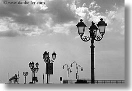 abstracts, black and white, clouds, europe, horizontal, italy, puglia, street lamps, taranto, photograph