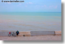 bicycles, europe, horizontal, italy, men, ocean, people, puglia, trani, photograph