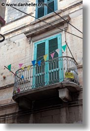balconies, europe, flags, italy, puglia, trani, vertical, windows, photograph
