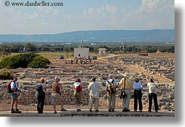 architectural ruins, europe, groups, horizontal, italy, looking, people, puglia, roman, tourists, photograph