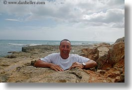 europe, holes, horizontal, italy, nello, nello de libero, people, puglia, rocks, tour guides, tourists, photograph