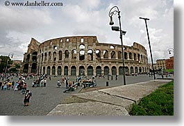 architectural ruins, archways, buildings, colosseum, crowds, europe, horizontal, italy, lamp posts, landmarks, people, piazza, rome, structures, photograph