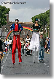 europe, italy, parade, people, rainbow, rome, stilts, vertical, walkers, photograph