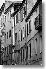 alghero, black and white, buildings, europe, italy, rows, sardinia, streets, vertical, photograph