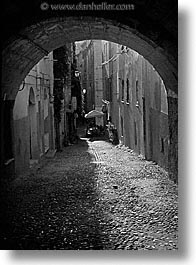 alghero, black and white, cobblestones, europe, italy, sardinia, streets, tunnel, vertical, photograph
