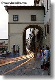 archways, cars, cobblestones, europe, florence, italy, light streaks, long exposure, motion blur, streets, tail lights, tunnel, tuscany, vertical, photograph