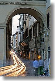 archways, cars, europe, florence, italy, light streaks, long exposure, motion blur, streets, tail lights, tunnel, tuscany, vertical, photograph