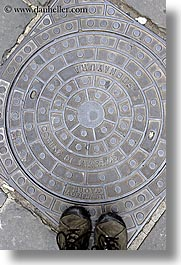 cobblestones, europe, feet, florence, italy, manhole covers, manholes, streets, tuscany, vertical, photograph