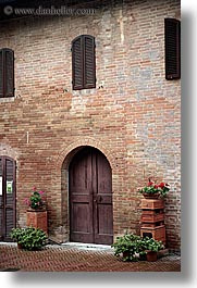 bricks, doors, europe, flowers, italy, monestaries, monte oliveto maggiore, tuscany, vertical, photograph