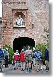 arts, bricks, europe, italy, monastery, monestaries, monte oliveto maggiore, religious, statues, tourists, tuscany, vertical, viewing, photograph