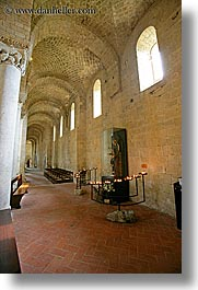 abbey, bricks, candles, churches, corridors, europe, italy, monestaries, religious, sant antimo, tuscany, vertical, windows, photograph