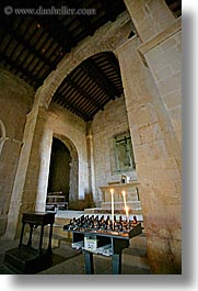 archways, candles, churches, europe, italy, monestaries, pieve di st leonardo, tuscany, vertical, photograph