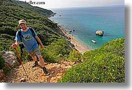 europe, hats, hiking, horizontal, isola giglio, italy, men, ocean, overlook, scenics, towns, tuscany, photograph