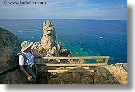 europe, hats, hiking, horizontal, isola giglio, italy, ocean, overlook, scenics, towns, tuscany, womens, photograph