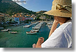 boats, europe, harbor, hats, horizontal, isola giglio, italy, ocean, towns, tuscany, womens, photograph