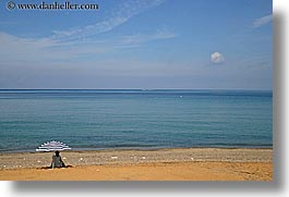 beaches, europe, horizontal, isola giglio, italy, ocean, towns, tuscany, umbrellas, under, womens, photograph