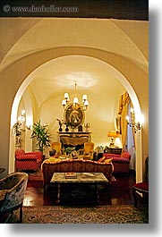 archways, chandelier, europe, hotels, italy, la bandita, living, rooms, towns, tuscany, vertical, villa, photograph
