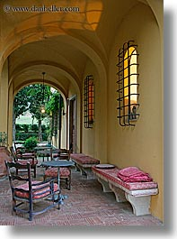 archways, bricks, chairs, europe, hotels, italy, la bandita, patio, towns, tuscany, vertical, villa, photograph