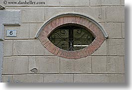 europe, eyes, horizontal, italy, montalcino, shaped, towns, tuscany, windows, photograph