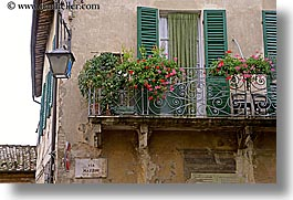 europe, flowers, horizontal, italy, montalcino, towns, tuscany, windows, photograph