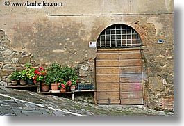 archways, doors, europe, flowers, geraniums, horizontal, italy, montalcino, towns, tuscany, photograph