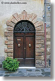 doors, europe, flowers, italy, montalcino, towns, tuscany, vertical, photograph